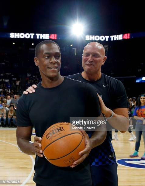 Rajon Rondo and Rex Chapman meet at center court during week seven of the BIG3 three on three basketball league at Rupp Arena on August 6 2017 in...
