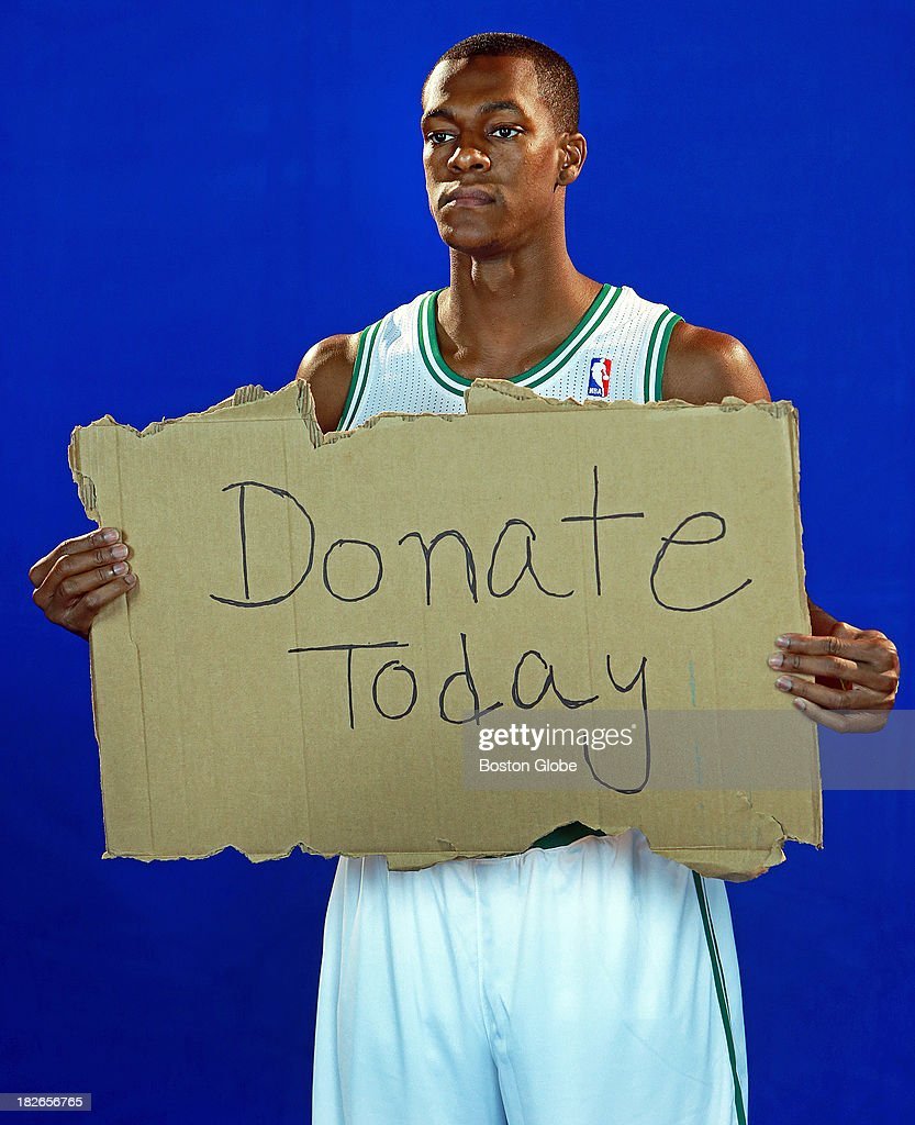 Rajon Rondo as he does a television promo. The Boston Celtics held their Media Day at the team's training facility at HealthPoint. Players posed for promotional photos, did television promos, signed autographed memorabilia, and took questions from reporters.