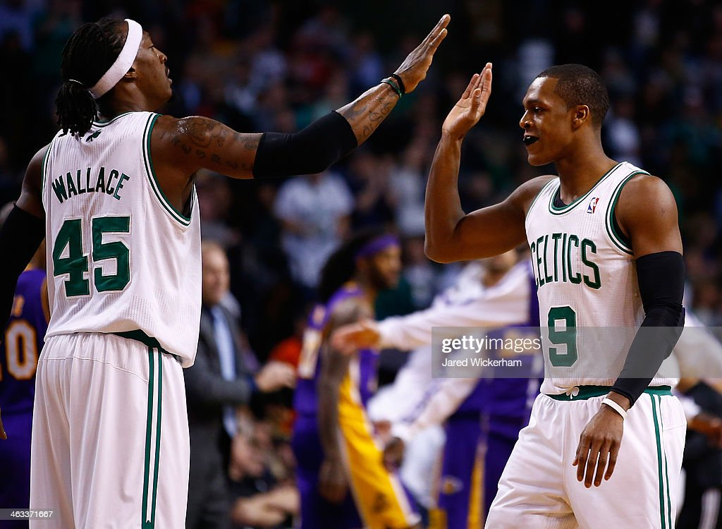 Rajon Rondo #9 is congratulated by teammate Gerald Wallace #45 of the Boston Celtics following a timeout in the second quarter against the Los Angeles Lakers during the game at TD Garden on January 17, 2014 in Boston, Massachusetts.