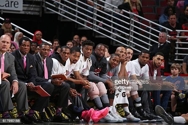 Rajon Rondo Jimmy Butler and Dwyane Wade of the Chicago Bulls look on from the bench against the Charlotte Hornets during an NBA preseason game on...