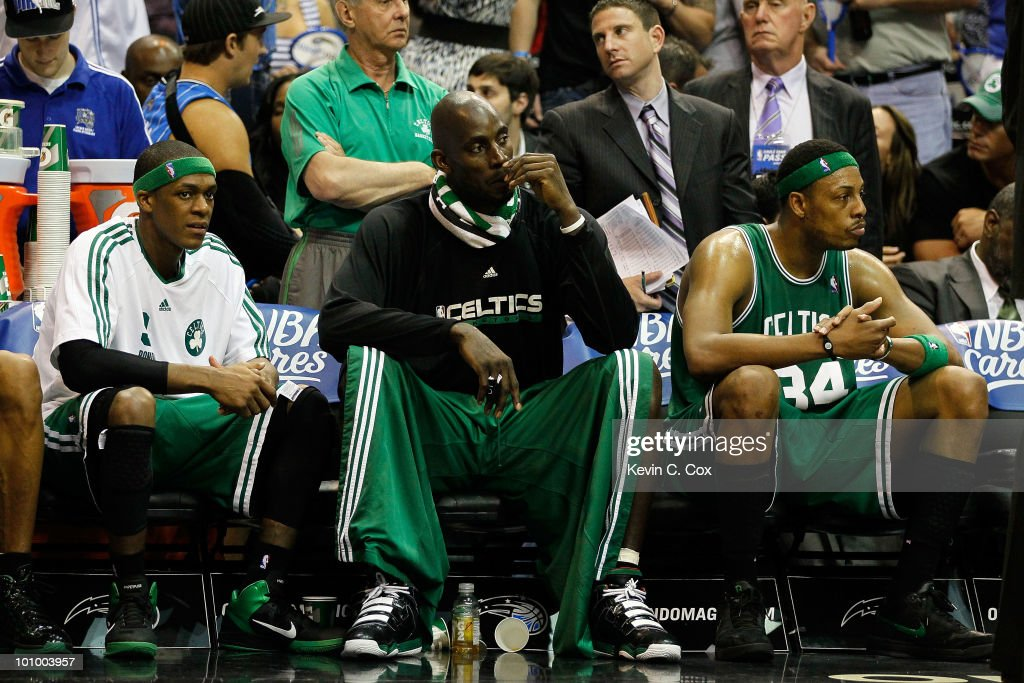 Rajon Rondo #9, Keivn Garnett #5 and Paul Pierce #34 of the Boston Celtics look on dejected from the bench in the final minutes of their 113-92 loss to the Orlando Magic in Game Five of the Eastern Conference Finals during the 2010 NBA Playoffs at Amway Arena on May 26, 2010 in Orlando, Florida.