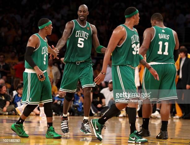 Rajon Rondo Kevin Garnett Paul Pierce and Glen Davis of the Boston Celtics walk across the court in the second half against the Los Angeles Lakers in...