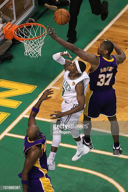 Rajon Rondo of the Boston Celltics drives for a shot attempt against Lamar Odom and Ron Artest of the Los Angeles Lakers during Game Four of the 2010...