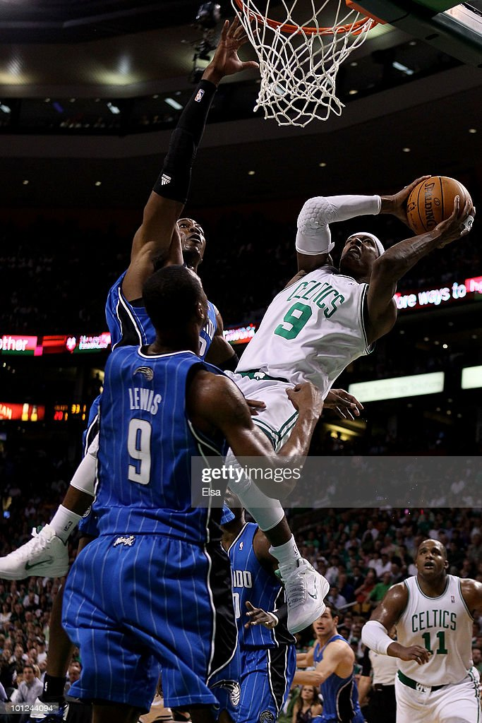 Rajon Rondo #9 of the Boston Celtics attempts a shot as he falls and was fouled against Dwight Howard #12 of the Orlando Magic in Game Six of the Eastern Conference Finals during the 2010 NBA Playoffs at TD Garden on May 28, 2010 in Boston, Massachusetts.