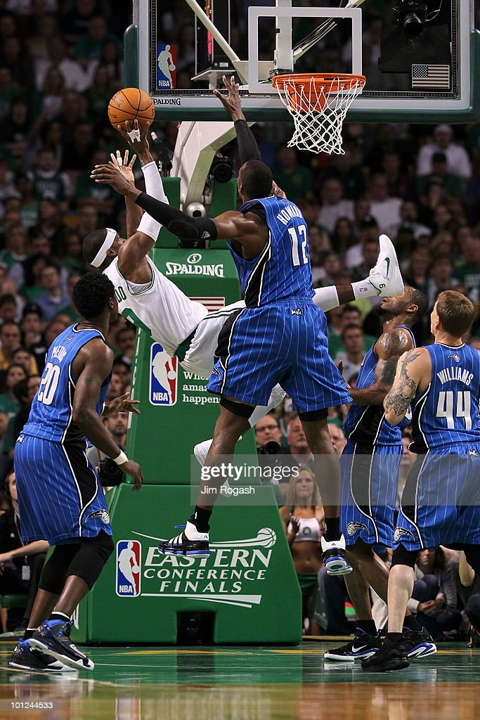 <a gi-track='captionPersonalityLinkClicked' href=/galleries/search?phrase=Rajon+Rondo&family=editorial&specificpeople=206983 ng-click='$event.stopPropagation()'>Rajon Rondo</a> #9 of the Boston Celtics attempts a shot as he falls and was fouled against <a gi-track='captionPersonalityLinkClicked' href=/galleries/search?phrase=Dwight+Howard&family=editorial&specificpeople=201570 ng-click='$event.stopPropagation()'>Dwight Howard</a> #12 of the Orlando Magic in Game Six of the Eastern Conference Finals during the 2010 NBA Playoffs at TD Garden on May 28, 2010 in Boston, Massachusetts.
