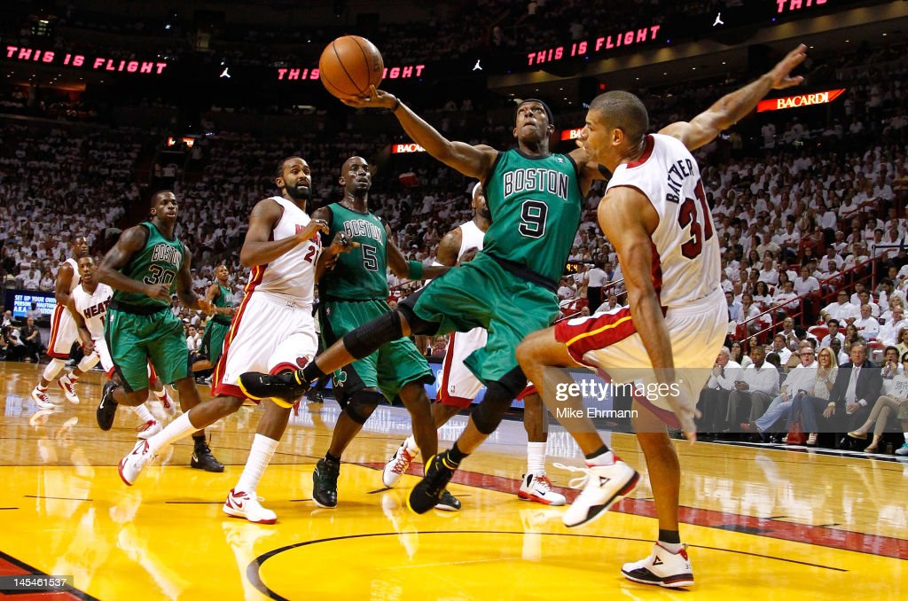 <a gi-track='captionPersonalityLinkClicked' href=/galleries/search?phrase=Rajon+Rondo&family=editorial&specificpeople=206983 ng-click='$event.stopPropagation()'>Rajon Rondo</a> #9 of the Boston Celtics attempts a shot in the first quarter as he drives and draws contact against <a gi-track='captionPersonalityLinkClicked' href=/galleries/search?phrase=Shane+Battier&family=editorial&specificpeople=201814 ng-click='$event.stopPropagation()'>Shane Battier</a> #31 of the Miami Heat in Game Two of the Eastern Conference Finals in the 2012 NBA Playoffs on May 30, 2012 at American Airlines Arena in Miami, Florida.