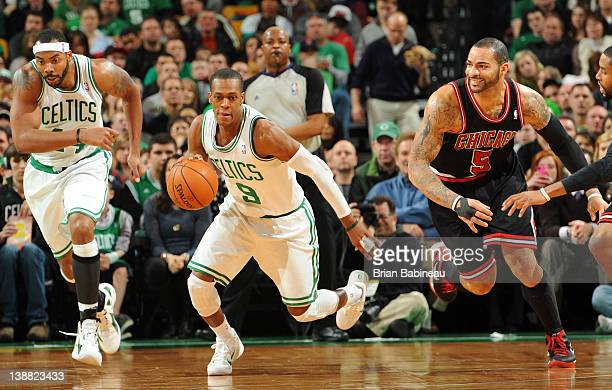 Rajon Rondo of the Boston Celtics dribbles the ball against Carlos Boozer of the Chicago Bulls on February 12 2012 at the TD Garden in Boston...