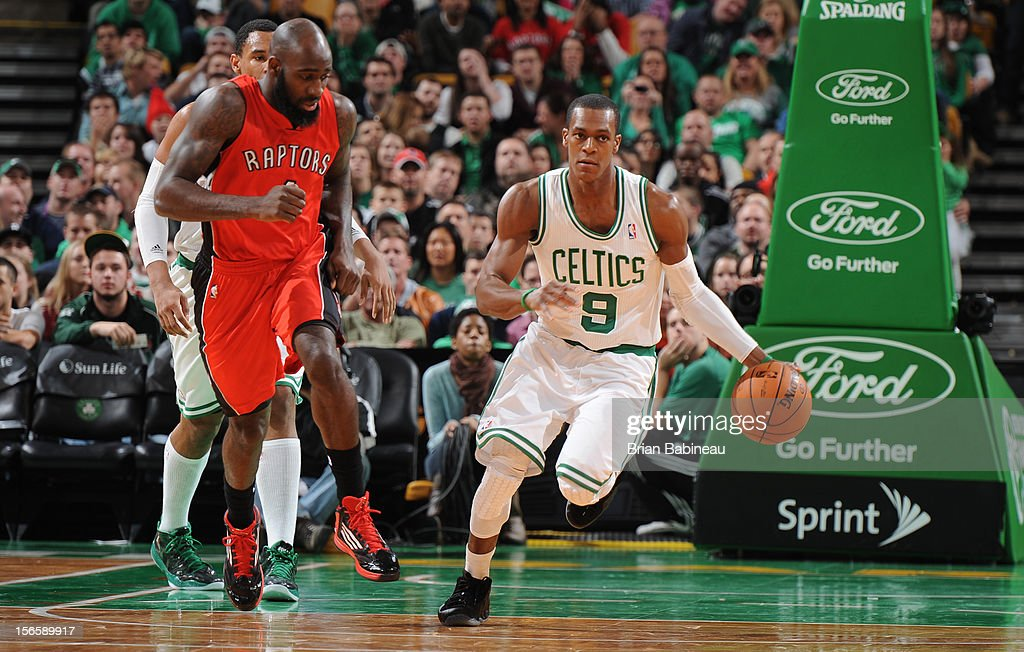 Rajon Rondo #9 of the Boston Celtics dribbles the ball upcourt while being guarded by Quincy Acy #4 of the Toronto Raptors on November 17, 2012 at the TD Garden in Boston, Massachusetts.