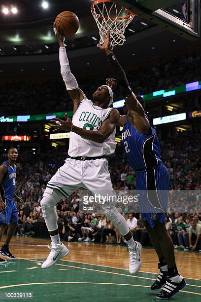 Rajon Rondo of the Boston Celtics drives for a shot attempt against Dwight Howard of the Orlando Magic at TD Banknorth Garden in Game Three of the...