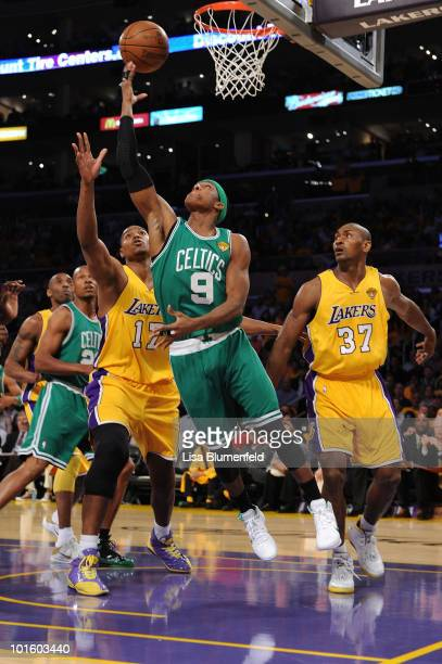 Rajon Rondo of the Boston Celtics drives for a shot attempt against Andrew Bynum and Ron Artest of the Los Angeles Lakers in Game One of the 2010 NBA...