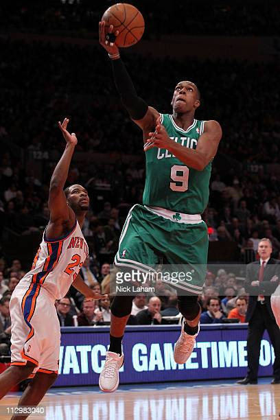 Rajon Rondo of the Boston Celtics drives for a shot attempt against Toney Douglas of the New York Knicks in Game Three of the Eastern Conference...