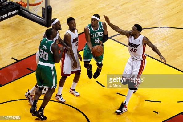 Rajon Rondo of the Boston Celtics drives for a shot attempt against LeBron James Norris Cole and Udonis Haslem of the Miami Heat in the first half of...