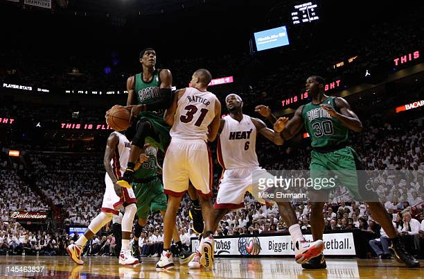 Rajon Rondo of the Boston Celtics drives for a shot attempt in the first half against Shane Battier and LeBron James of the Miami Heat in Game Two of...