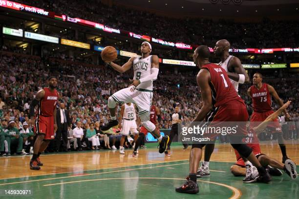 Rajon Rondo of the Boston Celtics drives for a shot attempt in the first half against the Miami Heat in Game Six of the Eastern Conference Finals in...
