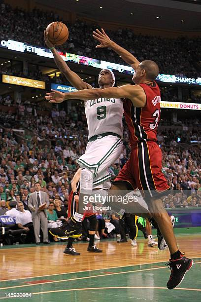 Rajon Rondo of the Boston Celtics drives for a shot attempt in the first half against Shane Battier of the Miami Heat in Game Six of the Eastern...