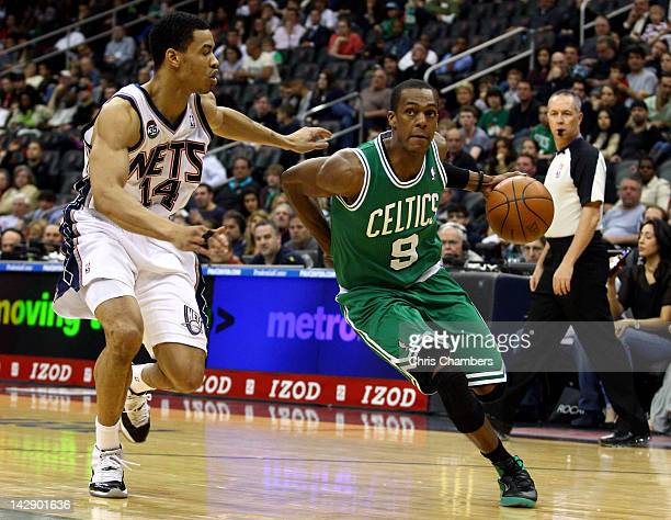Rajon Rondo of the Boston Celtics drives in the first half against Gerald Green of the New Jersey Nets at Prudential Center on April 14 2012 in...