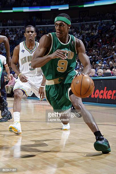 Rajon Rondo of the Boston Celtics drives past Chris Paul of the New Orleans Hornets at the New Orleans Arena March 22 2008 in New Orleans Louisiana...