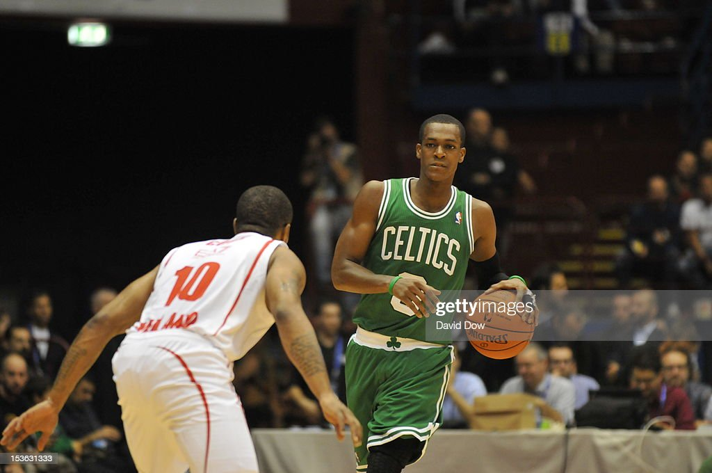 <a gi-track='captionPersonalityLinkClicked' href=/galleries/search?phrase=Rajon+Rondo&family=editorial&specificpeople=206983 ng-click='$event.stopPropagation()'>Rajon Rondo</a> #9 of the Boston Celtics drives the ball during the game between the Boston Celtics and the EA7 Emporio Armani Milano during NBA Europe Live Tour at the Mediolanum Forum on October 7, 2012 in Milan, Italy.
