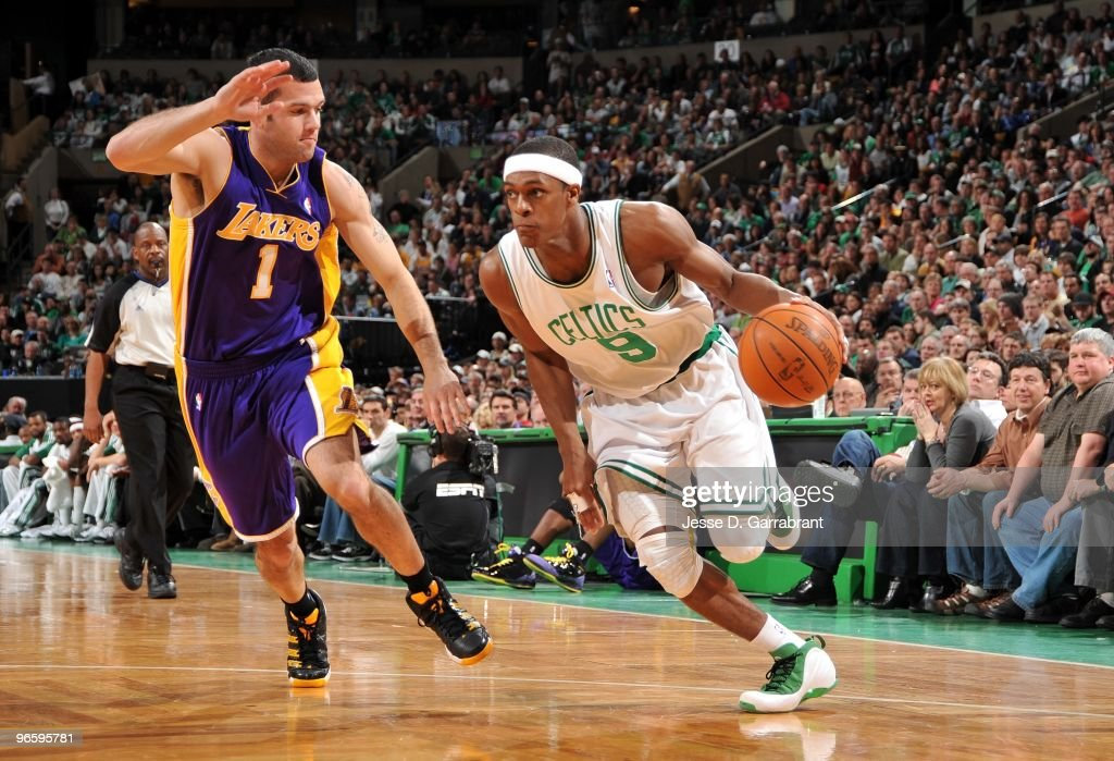 <a gi-track='captionPersonalityLinkClicked' href=/galleries/search?phrase=Rajon+Rondo&family=editorial&specificpeople=206983 ng-click='$event.stopPropagation()'>Rajon Rondo</a> #9 of the Boston Celtics drives the ball up court against <a gi-track='captionPersonalityLinkClicked' href=/galleries/search?phrase=Jordan+Farmar&family=editorial&specificpeople=228137 ng-click='$event.stopPropagation()'>Jordan Farmar</a> #1 of the Los Angeles Lakers during the game at The TD Garden on January 31, 2010 in Boston, Massachusetts. The Lakers won 90-89.