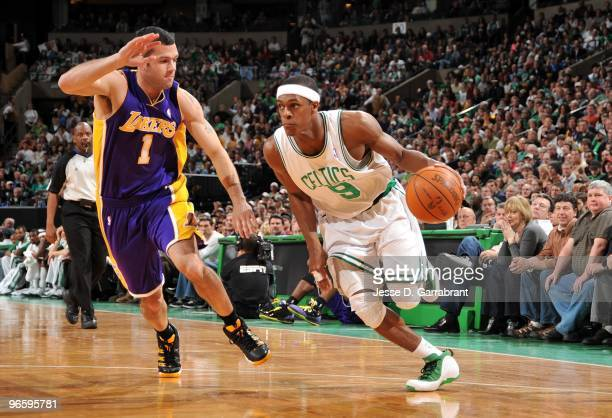 Rajon Rondo of the Boston Celtics drives the ball up court against Jordan Farmar of the Los Angeles Lakers during the game at The TD Garden on...