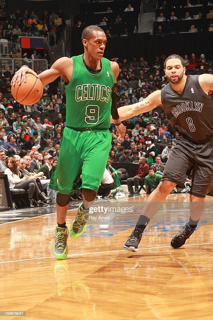 Rajon Rondo #9 of the Boston Celtics drives to the basket against Deron Williams #8 of the Brooklyn Nets on December 25, 2012 at the Barclays Center in Brooklyn, New York.