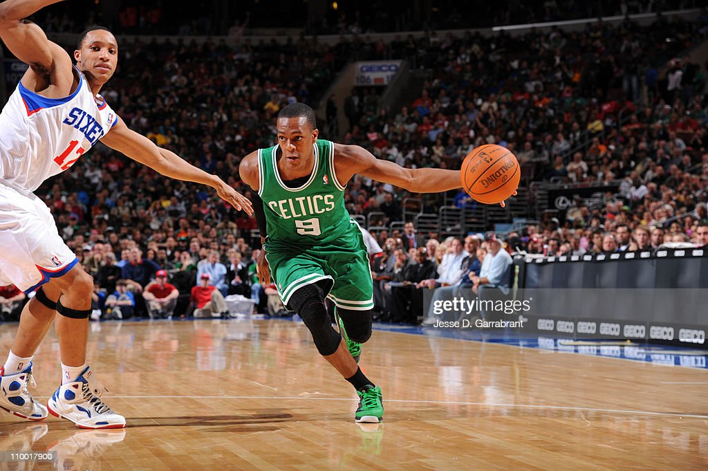 <a gi-track='captionPersonalityLinkClicked' href=/galleries/search?phrase=Rajon+Rondo&family=editorial&specificpeople=206983 ng-click='$event.stopPropagation()'>Rajon Rondo</a> #9 of the Boston Celtics drives to the basket against <a gi-track='captionPersonalityLinkClicked' href=/galleries/search?phrase=Evan+Turner&family=editorial&specificpeople=4665764 ng-click='$event.stopPropagation()'>Evan Turner</a> #12 of the Philadelphia 76ers on March 11, 2011 at the Wells Fargo Center in Philadelphia, Pennsylvania.