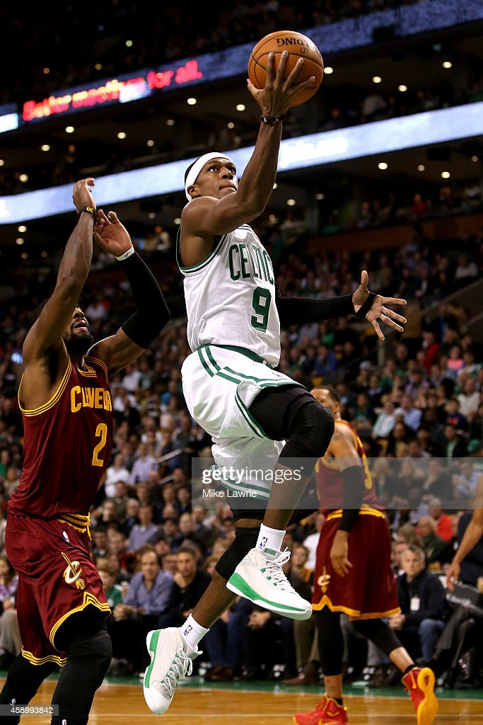 Rajon Rondo #9 of the Boston Celtics drives to the basket against Kyrie Irving #2 of the Cleveland Cavaliers in the first half at TD Garden on November 14, 2014 in Boston, Massachusetts.
