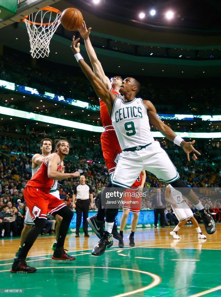 Rajon Rondo #9 of the Boston Celtics drives to the basket in front of Kirk Hinrich #12 of the Chicago Bulls in the first period during the game at TD Garden on March 30, 2014 in Boston, Massachusetts.