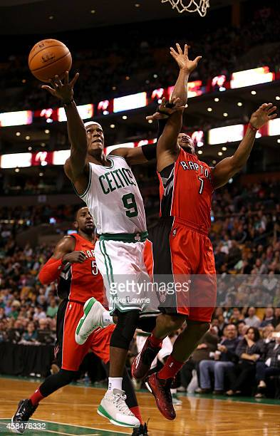 Rajon Rondo of the Boston Celtics drives to the basket in the first half against Kyle Lowry of the Toronto Raptors at TD Garden on November 5 2014 in...
