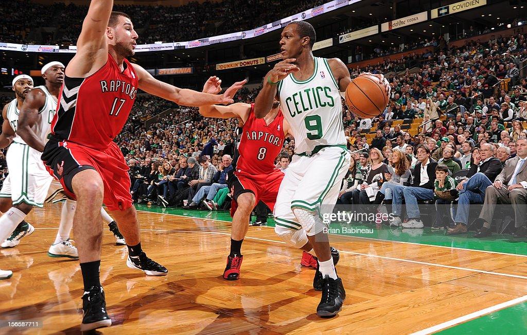 Rajon Rondo #9 of the Boston Celtics drives to the basket while guarded by Jonas Valanciunas #17 and Jose Calderon #8 both of the Toronto Raptors on November 17, 2012 at the TD Garden in Boston, Massachusetts.