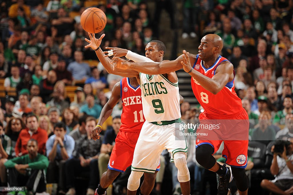 <a gi-track='captionPersonalityLinkClicked' href=/galleries/search?phrase=Rajon+Rondo&family=editorial&specificpeople=206983 ng-click='$event.stopPropagation()'>Rajon Rondo</a> #9 of the Boston Celtics fights for the ball against <a gi-track='captionPersonalityLinkClicked' href=/galleries/search?phrase=Damien+Wilkins&family=editorial&specificpeople=204651 ng-click='$event.stopPropagation()'>Damien Wilkins</a> #8 of the Philadelphia 76ers on October 21, 2012 at the TD Garden in Boston, Massachusetts.