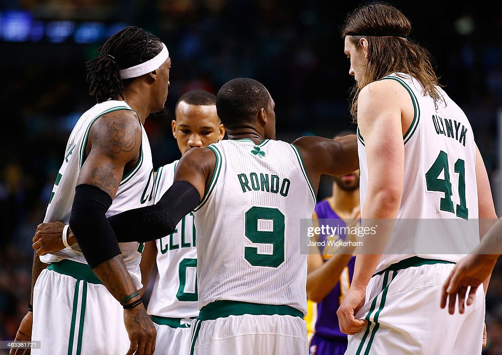 Rajon Rondo #9 of the Boston Celtics gathers his teammates including Kelly Olynyk #41 and Gerald Wallace #45 in the fourth quarter against the Los Angeles Lakers during the game at TD Garden on January 17, 2014 in Boston, Massachusetts.