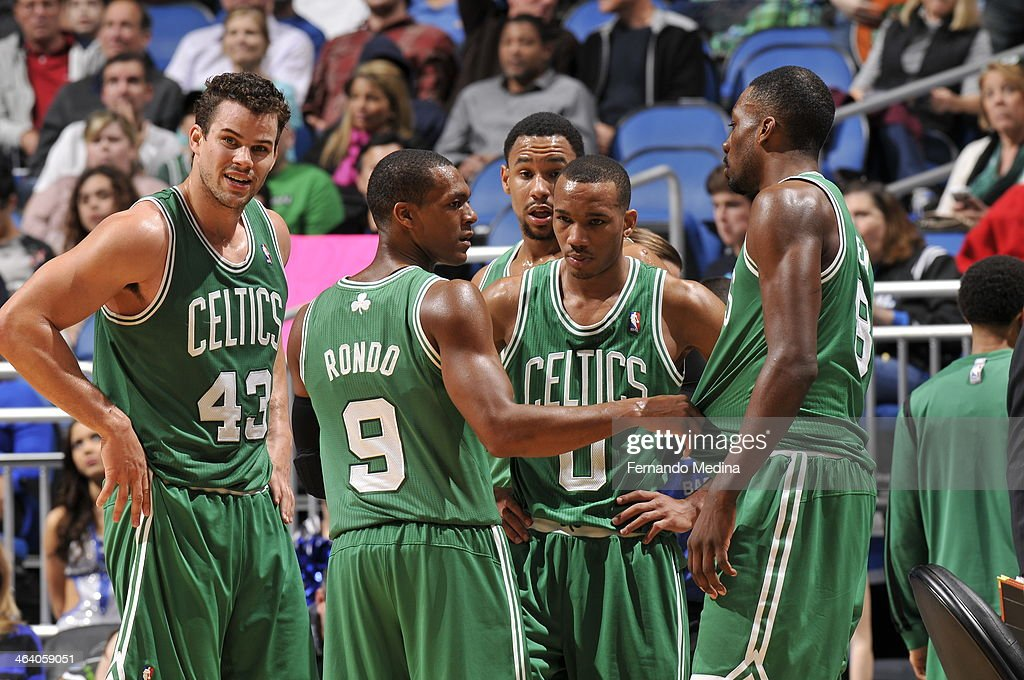 <a gi-track='captionPersonalityLinkClicked' href=/galleries/search?phrase=Rajon+Rondo&family=editorial&specificpeople=206983 ng-click='$event.stopPropagation()'>Rajon Rondo</a> #9 of the Boston Celtics gives direction with his teammates against the Orlando Magic during the game on January 19, 2014 at Amway Center in Orlando, Florida.