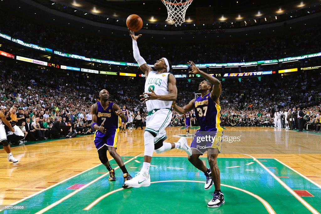 <a gi-track='captionPersonalityLinkClicked' href=/galleries/search?phrase=Rajon+Rondo&family=editorial&specificpeople=206983 ng-click='$event.stopPropagation()'>Rajon Rondo</a> #9 of the Boston Celtics goes to the basket against <a gi-track='captionPersonalityLinkClicked' href=/galleries/search?phrase=Lamar+Odom&family=editorial&specificpeople=201519 ng-click='$event.stopPropagation()'>Lamar Odom</a> #7 and <a gi-track='captionPersonalityLinkClicked' href=/galleries/search?phrase=Ron+Artest&family=editorial&specificpeople=201763 ng-click='$event.stopPropagation()'>Ron Artest</a> #37 of the Los Angeles Lakers during Game Five of the 2010 NBA Finals on June 13, 2010 at TD Garden in Boston, Massachusetts.