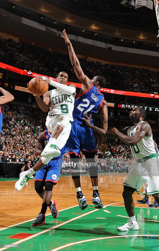 Rajon Rondo #9 of the Boston Celtics goes to the basket against Thaddeus Young #21 of the Philadelphia 76ers on December 8, 2012 at the TD Garden in Boston, Massachusetts.