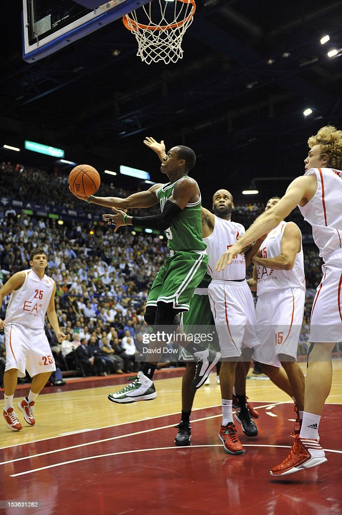 <a gi-track='captionPersonalityLinkClicked' href=/galleries/search?phrase=Rajon+Rondo&family=editorial&specificpeople=206983 ng-click='$event.stopPropagation()'>Rajon Rondo</a> #9 of the Boston Celtics goes to the basket during the game between the Boston Celtics and the EA7 Emporio Armani Milano during NBA Europe Live Tour at the Mediolanum Forum on October 7, 2012 in Milan, Italy.