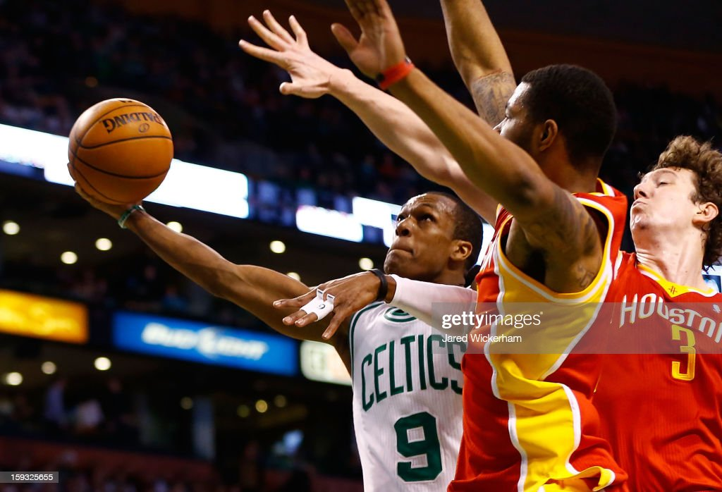 Rajon Rondo #9 of the Boston Celtics goes up for a layup against Omer Asik #3 of the Houston Rockets during the game on January 11, 2013 at TD Garden in Boston, Massachusetts.