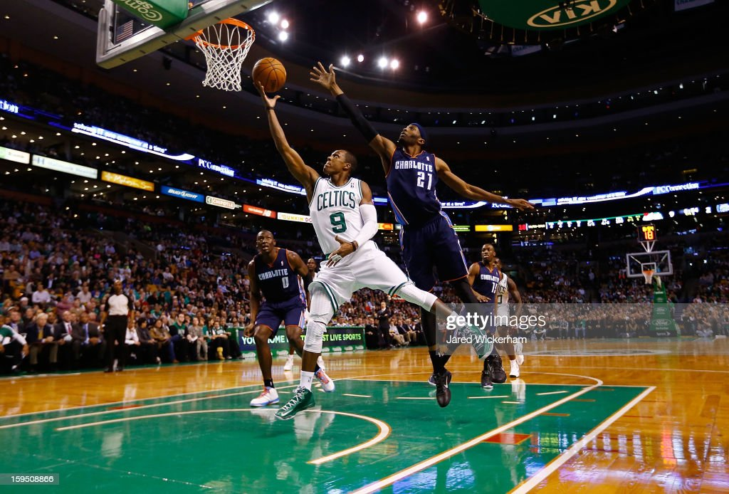 Rajon Rondo #9 of the Boston Celtics goes up for a layup in front of Hakim Warrick #21 of the Charlotte Bobcats during the game on January 14, 2013 at TD Garden in Boston, Massachusetts.