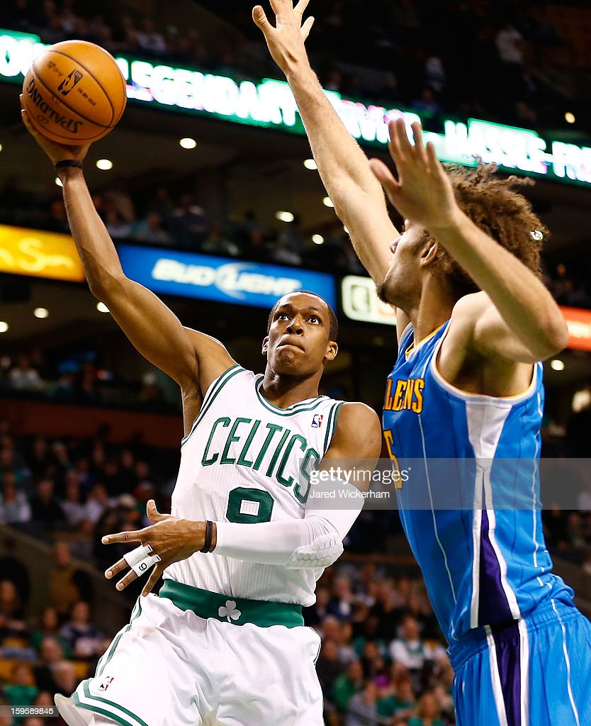 Rajon Rondo #9 of the Boston Celtics goes up for a layup in front of Robin Lopez #15 of the New Orleans Hornets during the game on January 16, 2013 at TD Garden in Boston, Massachusetts.