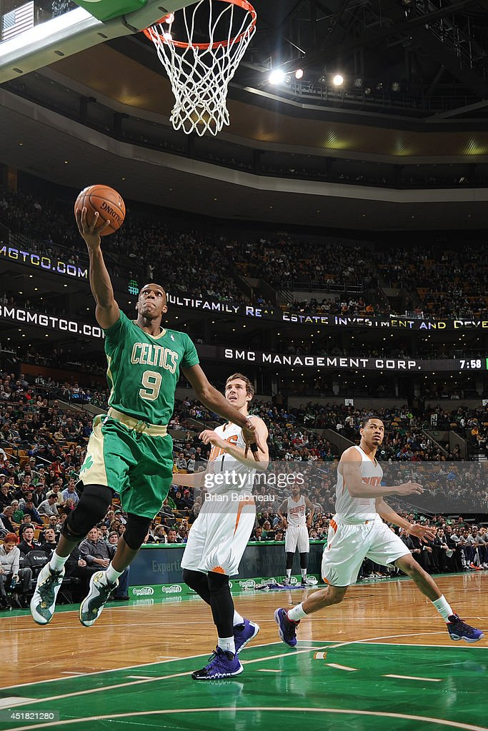 <a gi-track='captionPersonalityLinkClicked' href=/galleries/search?phrase=Rajon+Rondo&family=editorial&specificpeople=206983 ng-click='$event.stopPropagation()'>Rajon Rondo</a> #9 of the Boston Celtics goes up for a shot against the Phoenix Suns on March 14, 2014 at the TD Garden in Boston, Massachusetts.