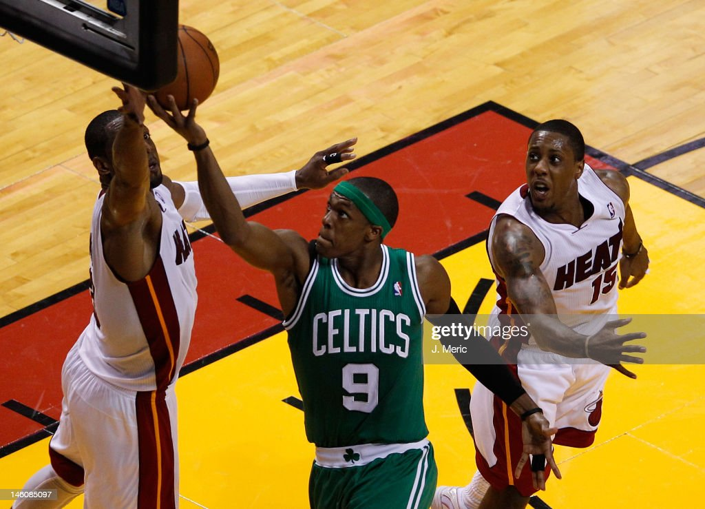 Rajon Rondo of the Boston Celtics goes up for a shot between Dwyane Wade and Mario Chalmers of the Miami Heat in the first half in Game Seven of the...