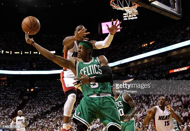Rajon Rondo of the Boston Celtics goes up for a shot over his head against Dwyane Wade of the Miami Heat in the second quarter in Game Seven of the...