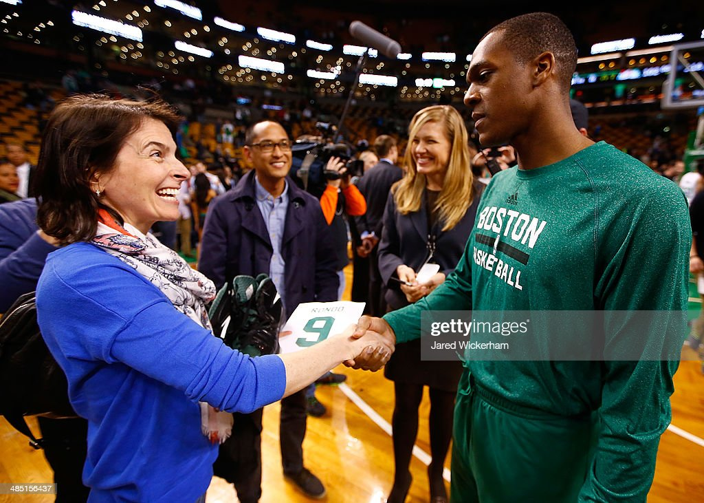 Rajon Rondo #9 of the Boston Celtics greets a fan after giving her his shoes following their loss to the Washington Wizards at TD Garden on April 16, 2014 in Boston, Massachusetts.