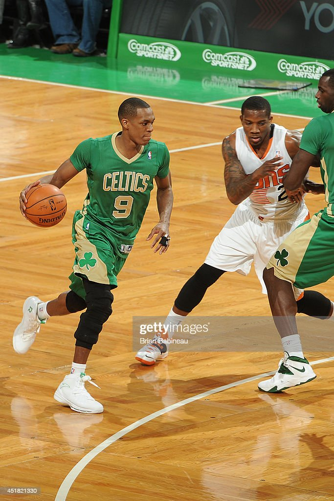 <a gi-track='captionPersonalityLinkClicked' href=/galleries/search?phrase=Rajon+Rondo&family=editorial&specificpeople=206983 ng-click='$event.stopPropagation()'>Rajon Rondo</a> #9 of the Boston Celtics handles the ball against the Phoenix Suns on March 14, 2014 at the TD Garden in Boston, Massachusetts.