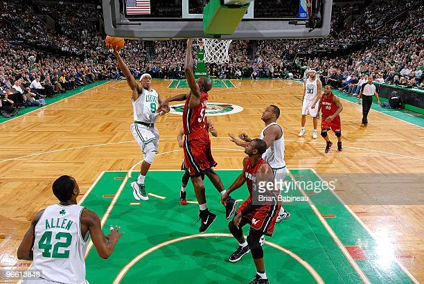 Rajon Rondo of the Boston Celtics hooks a shot over Joel Anthony of the Miami Heat during the game on February 3 2010 at TD Banknorth Garden in...