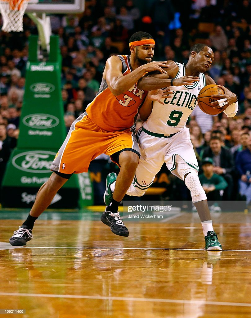 Rajon Rondo #9 of the Boston Celtics is fouled by Jared Dudley #3 of the Phoenix Suns during the game on January 9, 2013 at TD Garden in Boston, Massachusetts.
