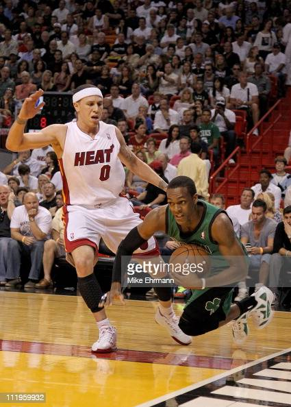Rajon Rondo of the Boston Celtics is fouled by Mike Bibby of the Miami Heat during a game at American Airlines Arena on April 10 2011 in Miami...