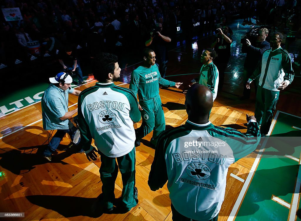 <a gi-track='captionPersonalityLinkClicked' href=/galleries/search?phrase=Rajon+Rondo&family=editorial&specificpeople=206983 ng-click='$event.stopPropagation()'>Rajon Rondo</a> #9 of the Boston Celtics is introduced with his teammates as part of the starting lineup prior to the game against the Los Angeles Lakers at TD Garden on January 17, 2014 in Boston, Massachusetts.