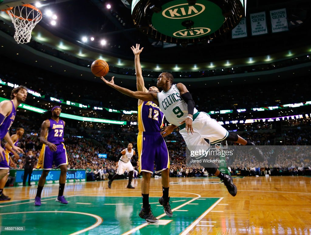 Rajon Rondo #9 of the Boston Celtics is midair for a layup in front of Kendall Marshall #12 of the Los Angeles Lakers in the second quarter during the game at TD Garden on January 17, 2014 in Boston, Massachusetts.