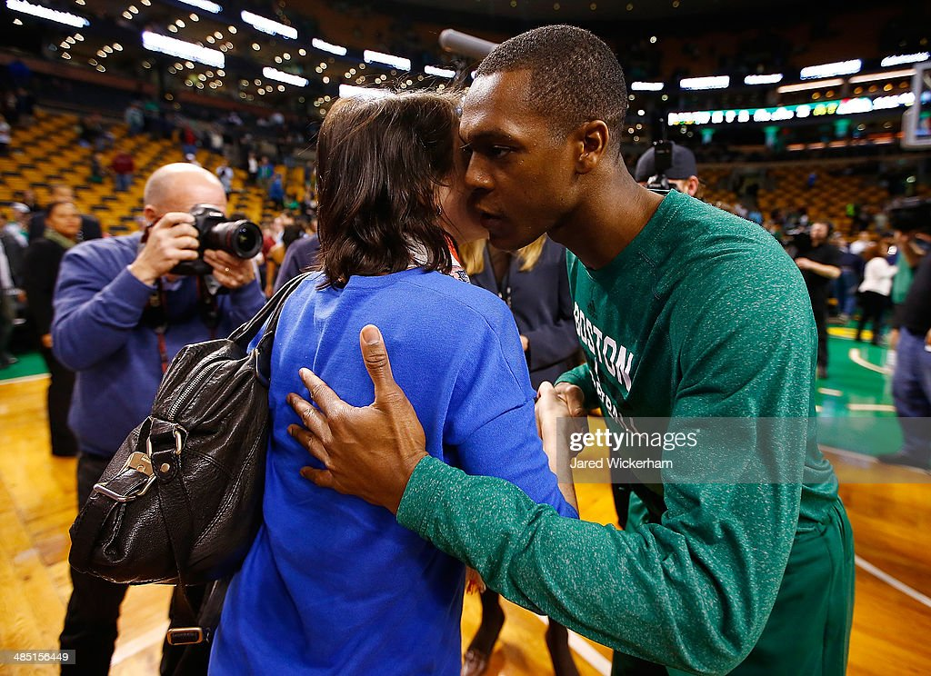 Rajon Rondo #9 of the Boston Celtics kisses a fan after giving her his shoes following their loss to the Washington Wizards at TD Garden on April 16, 2014 in Boston, Massachusetts.